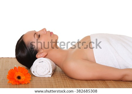 Beautiful woman in spa center on white background - stock photo