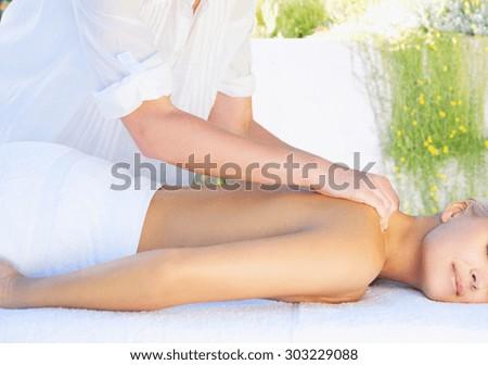 beautiful woman in spa salon getting massage - stock photo