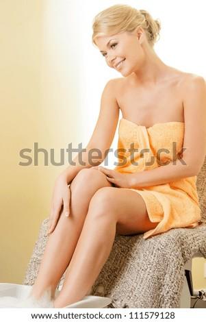 beautiful woman in spa salon having pedicure - stock photo
