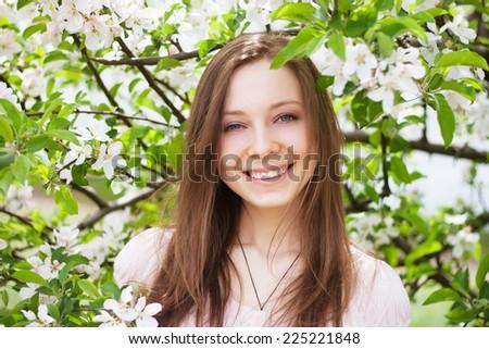 Beautiful woman in spring bloom - stock photo