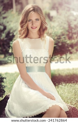 Beautiful woman in spring garden - stock photo