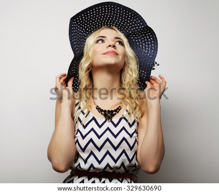 Beautiful woman in  straw summer hat