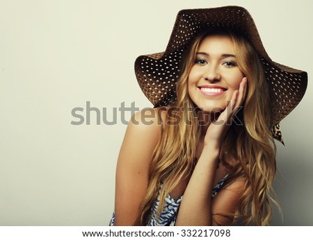 Beautiful woman in  straw summer hat - stock photo
