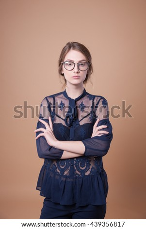 Beautiful woman in stylish new glasses, joy. Demonstration of clothing, young woman