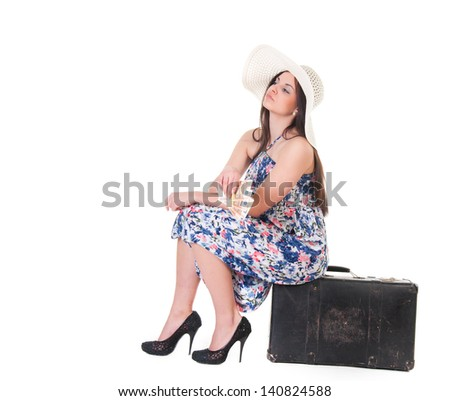 beautiful woman in summer dress with hat, case and money over white background - stock photo