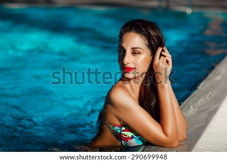 Beautiful woman in swimming pool summer vacation, sexy girl bikini fashion  summertime, tanned female model, luxury lifestyle, series - stock photo
