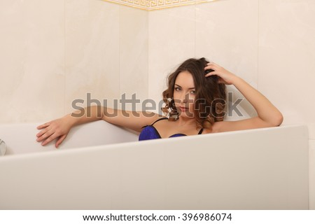 beautiful woman in the bathroom outdoor lingerie  - stock photo