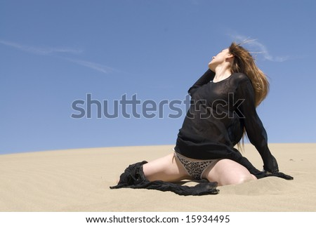 beautiful woman in the dunes of the desert