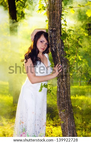 beautiful woman in the morning mist in spring forest - stock photo
