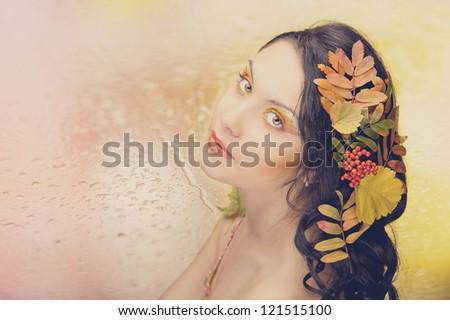 Beautiful woman in the toned autumn image. Beautiful creative makeup. - stock photo