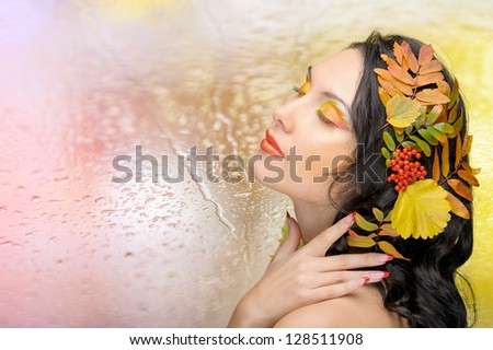 Beautiful woman in the toned autumn image. Beautiful creative makeup - stock photo