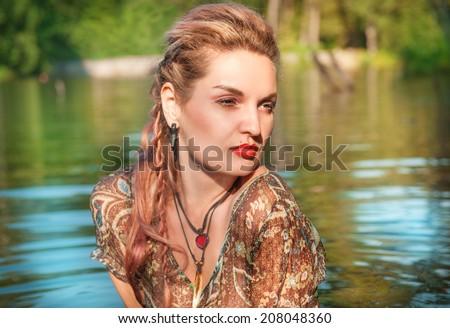 Beautiful woman in the water - stock photo