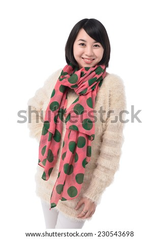 beautiful woman in warm clothes with scarf posing - stock photo