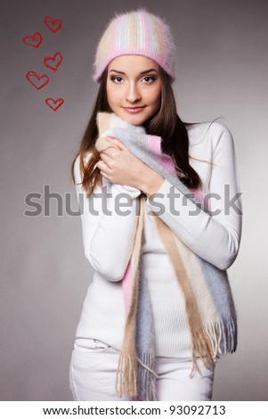 beautiful woman in warm clothing on gray background - stock photo