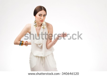 Beautiful woman in white dress on white  - stock photo