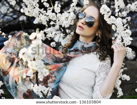 Beautiful woman in white flowers - stock photo