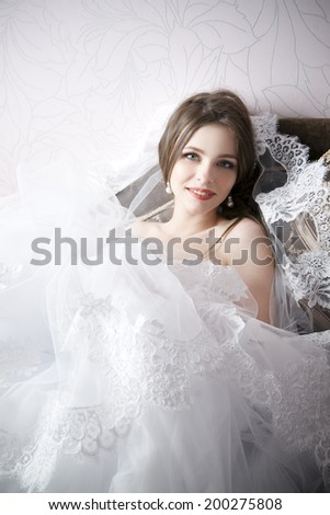 Beautiful woman in white wedding dress. Professional makeup hairstyle bride