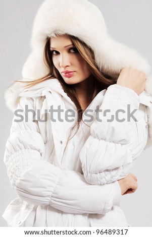 Beautiful woman in white winter clothing