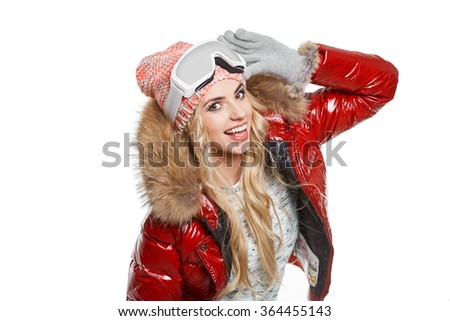 Beautiful woman in winter red jacket. Winter sport activity.