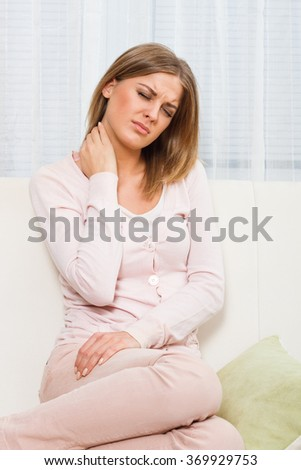 Beautiful woman is having pain in her neck.Neck pain