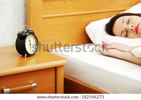 Beautiful woman is sleeping and resting in bed.