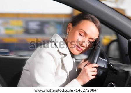 beautiful woman is sleeping in a car - stock photo