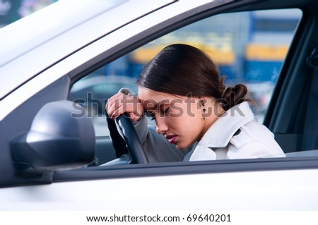 beautiful woman is sleeping in a car