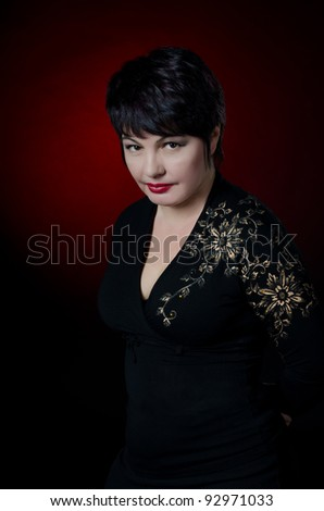 Beautiful woman isolated on a dark red background - stock photo
