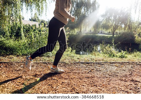 Beautiful woman jogging in  a park - stock photo