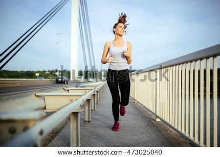 Beautiful woman jogging to stay fit