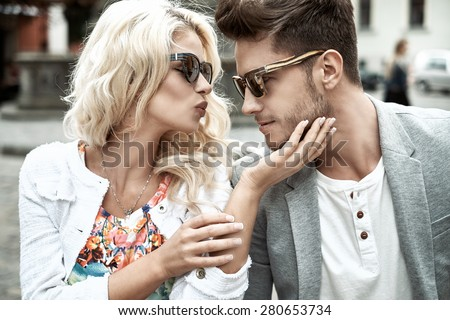 Beautiful woman kissing her boyfriend - stock photo