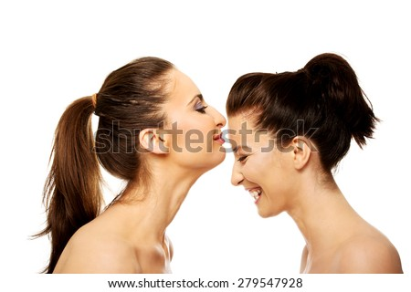 Beautiful woman kissing her friend in forehead. - stock photo