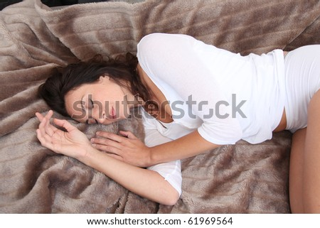 Beautiful woman laying in soft blanket