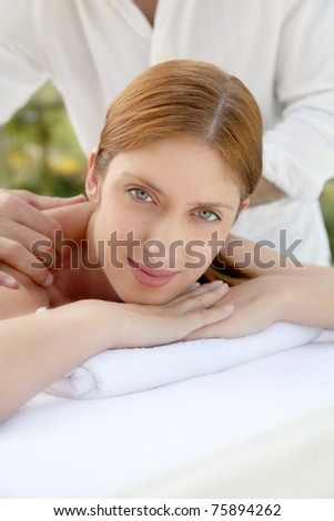 Beautiful woman laying on a massage bed