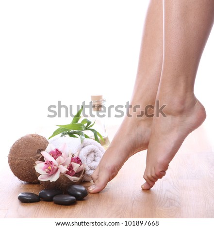 Beautiful woman legs and different spa items - stock photo