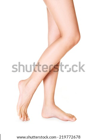 Beautiful woman legs isolated on white - stock photo