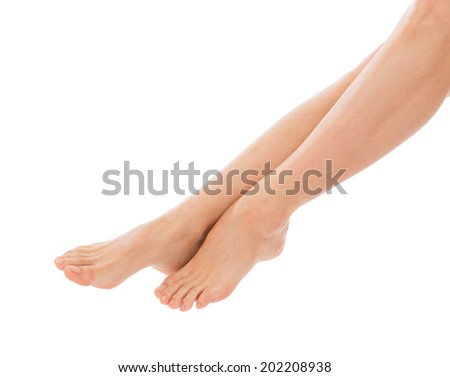 Beautiful woman legs knees and fingers isolated on white background. Skin and body care concept - stock photo