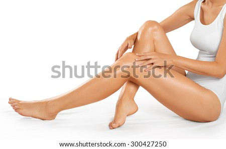 Beautiful woman legs on a white background. Body care. - stock photo