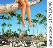 Beautiful woman legs on the beach. Vacation. - stock photo