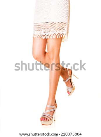 Beautiful woman legs wearing high heels. Isolated on white.  - stock photo