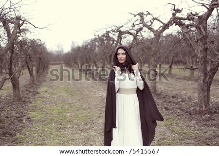 beautiful woman like a princess in a white dress in a fairy forest - stock photo