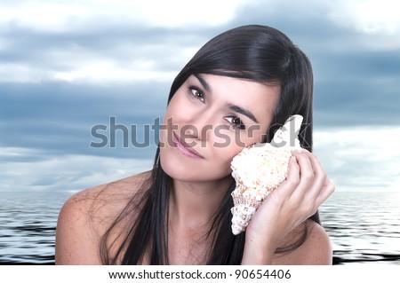 beautiful woman listening shell sound - stock photo