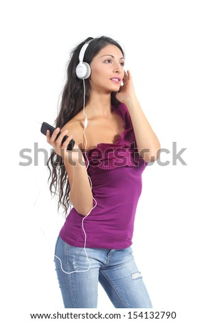 Beautiful woman listening to the music from a smart phone isolated on a white background              - stock photo