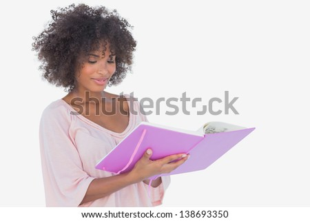 Beautiful woman looking at photo album on white background