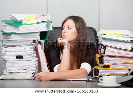 beautiful woman looking dreamingly in the office