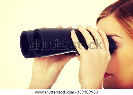 Beautiful woman looking into binoculars. - stock photo