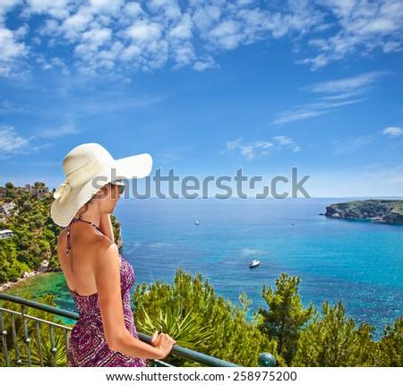 Beautiful woman looking on Valtos beach near Parga town of Syvota area in Greece. - stock photo