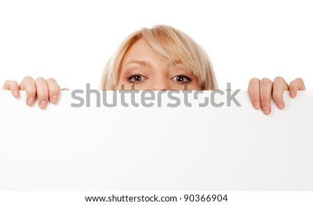 Beautiful woman looking surprised. Isolated over white. - stock photo