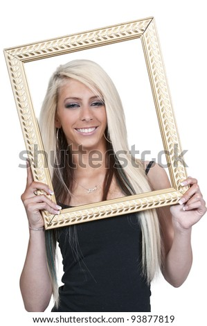 Beautiful woman looking through an ornate picture frame