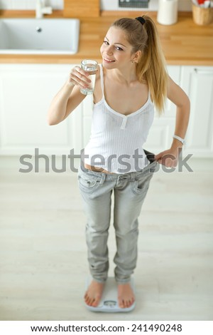 Beautiful woman lost weight - stock photo
